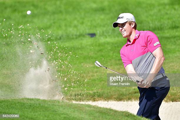 Andrew Dodt of Australia hits from a bunker during the first round of the BMW International Open at Gut Larchenhof on June 23 2016 in Cologne Germany