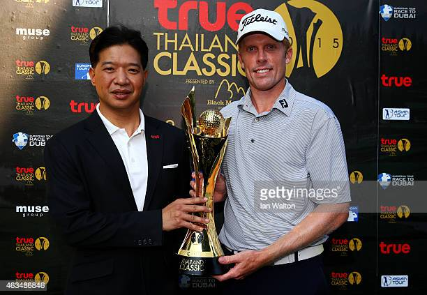 Andrew Dodt of Australia is presented with the trophy after victory in the 2015 True Thailand Classic at Black Mountain Golf Club on February 15 2015...