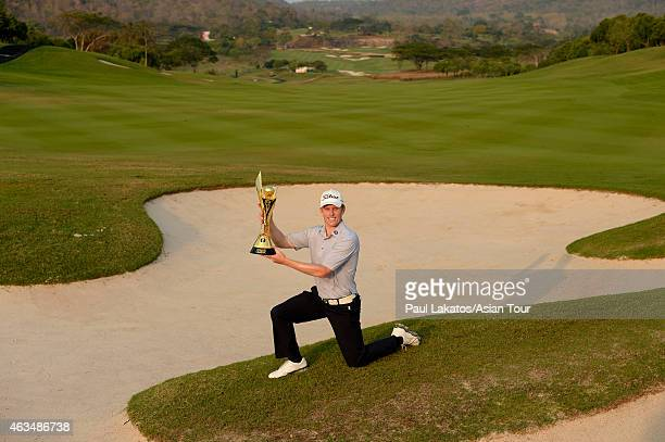 Andrew Dodt of Australia pictured with the winner's trophy during round four of the Thailand Classic at Black Mountain Golf Club on February 15 2015...