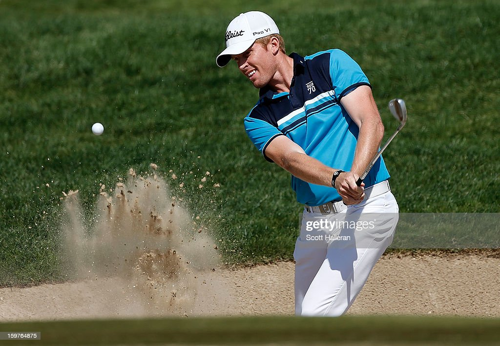 Andrew Dodt of Australia plays a bunker shot on the second hole during the final round of the Abu Dhabi HSBC Golf Championship at Abu Dhabi Golf Club on January 20, 2013 in Abu Dhabi, United Arab Emirates.