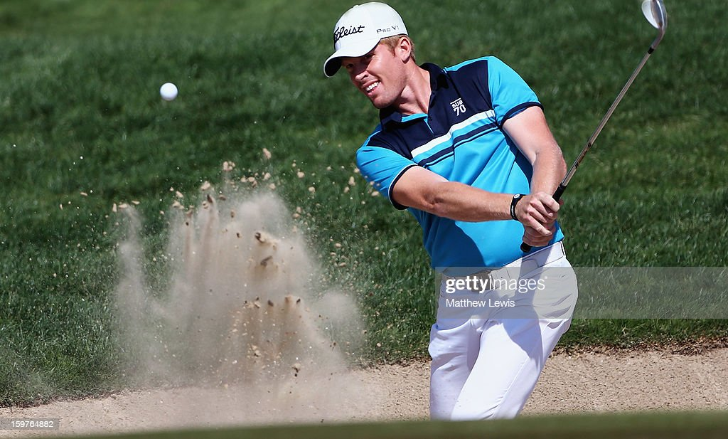 Andrew Dodt of Australia plays out of a bunker on the 2nd hole during day four of the Abu Dhabi HSBC Golf Championship at Abu Dhabi Golf Club on January 20, 2013 in Abu Dhabi, United Arab Emirates.
