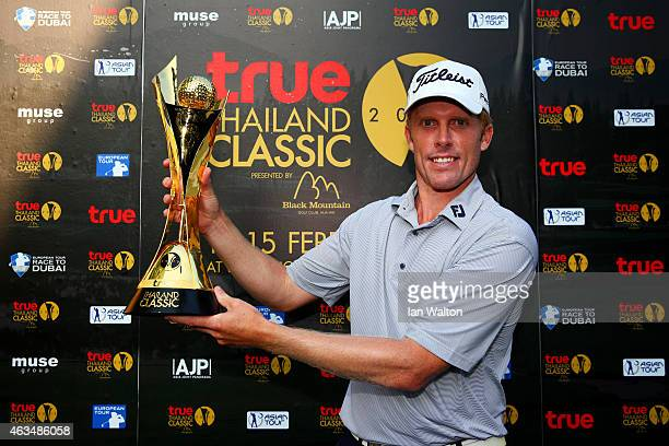 Andrew Dodt of Australia poses with the trophy after victory in the 2015 True Thailand Classic at Black Mountain Golf Club on February 15 2015 in Hua...