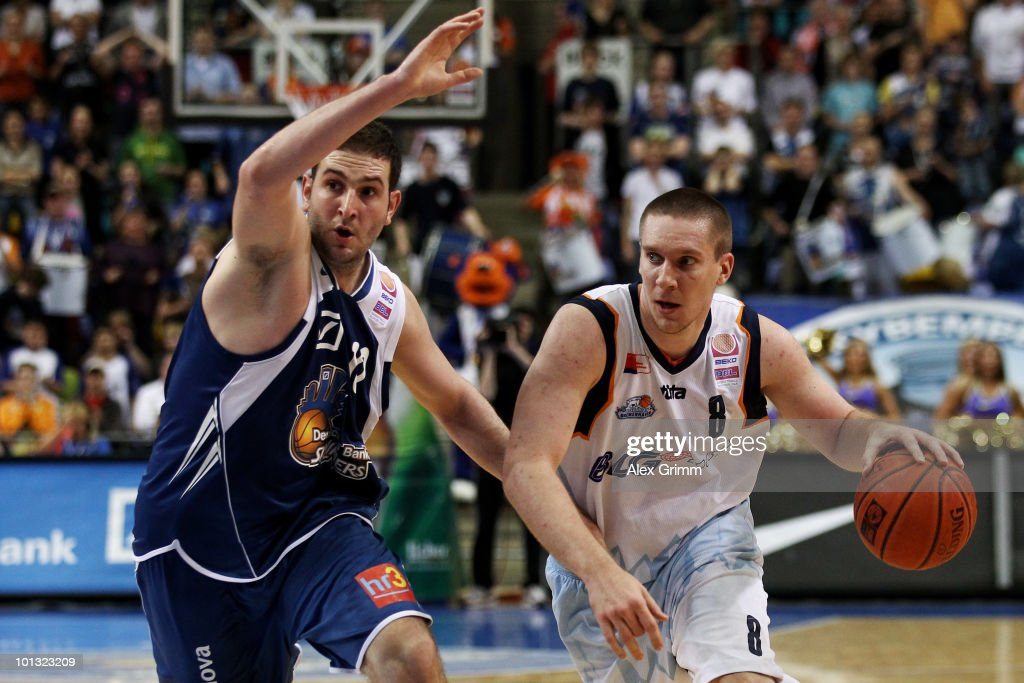 Andrew Drevo of Bremerhaven is challenged by Dragan Labovic of Frankfurt during the Beko Basketball Bundesliga play off match between Deutsche Bank...