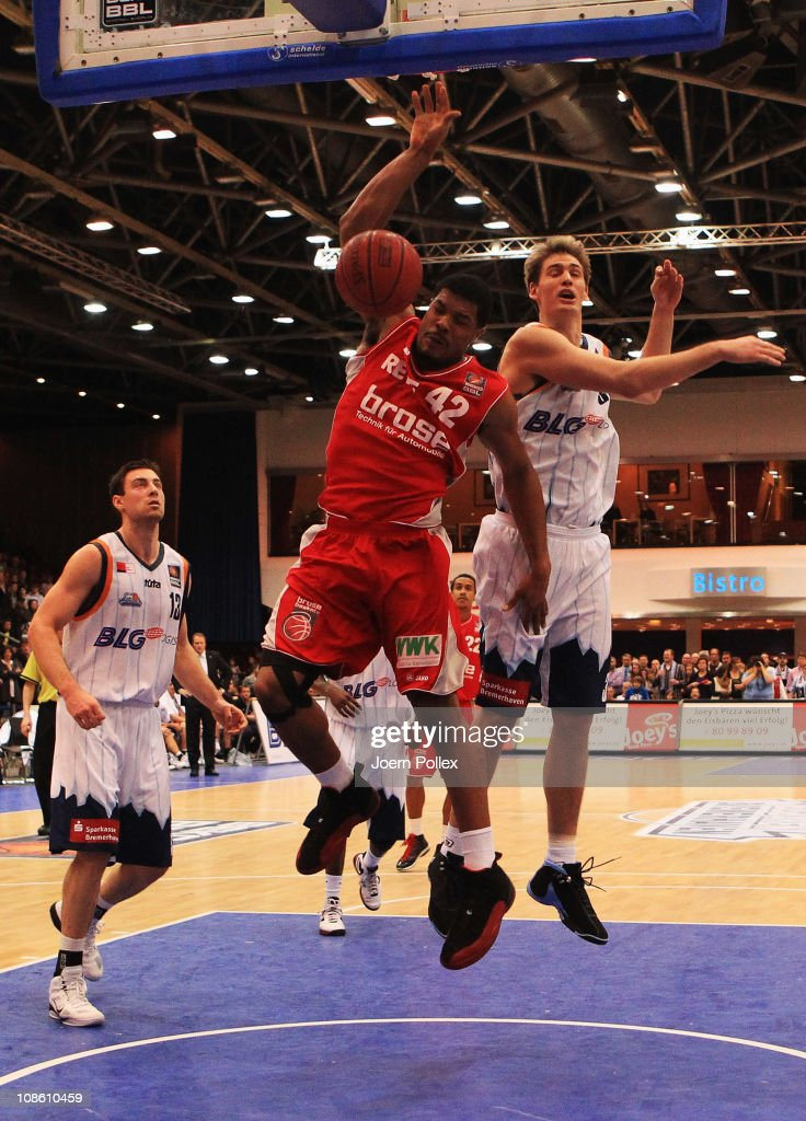 Andrew Drevo of Bremerhaven moves against Kyle Hines of Brose Baskets during the Basketball Bundesliga match between Eisbaeren Bremerhaven and Brose...