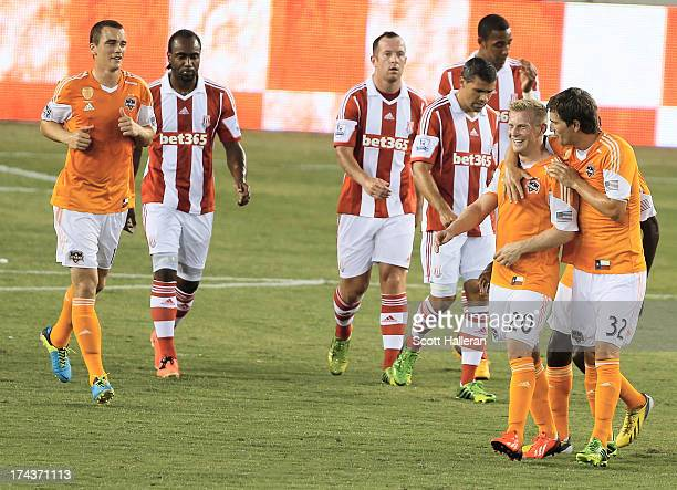 Andrew Driver and Bobby Boswell of the Houston Dynamo celebrate after Driver scored a first half goal against Stoke City during the Dynamo Charities...