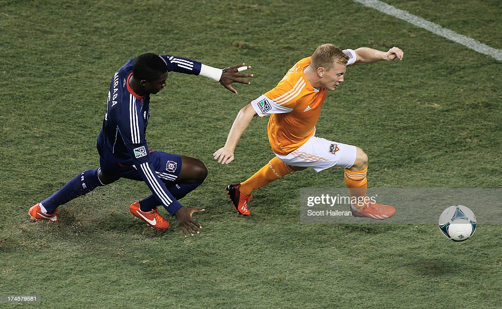 Andrew Driver #20 of the Houston Dynamo works the ball against Jalil Anibaba #6 of the Chicago Fire at BBVA Compass Stadium on July 27, 2013 in Houston, Texas.