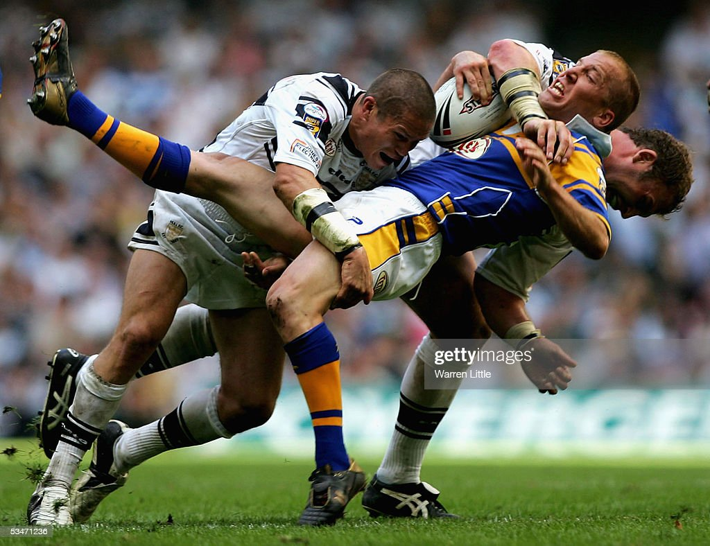 Andrew Dunemann of Leeds can not find a way through as he is upended by the Hull defence during the Powergen Challenge Cup Final between Hull FC and...