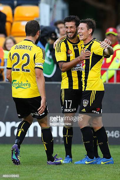 Andrew Durante and Vince Lia of the Phoenix congratulate teammate Nathan Burns on his goal during the round 20 ALeague match between the Wellington...