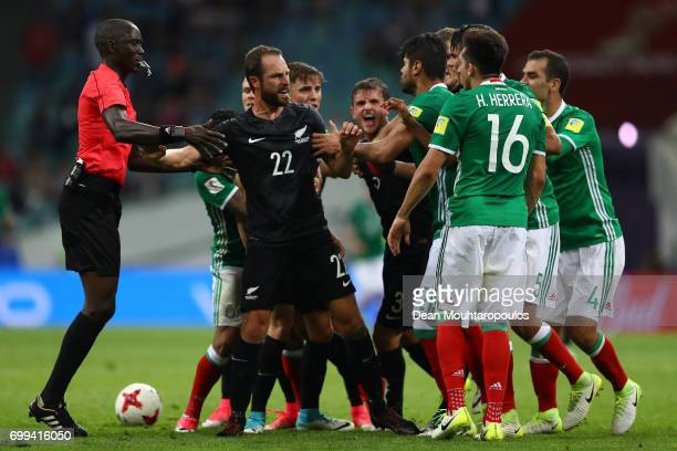 Andrew Durante of New ealand clashes with Hector Herrera of Mexico during the FIFA Confederations Cup Russia 2017 Group A match between Mexico and...