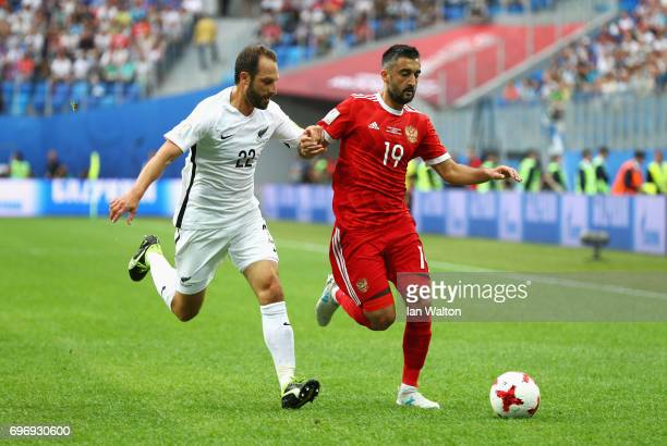 Andrew Durante of New Zealand and Alexander Samedov of Russia battle for possession during the FIFA Confederations Cup Russia 2017 Group A match...