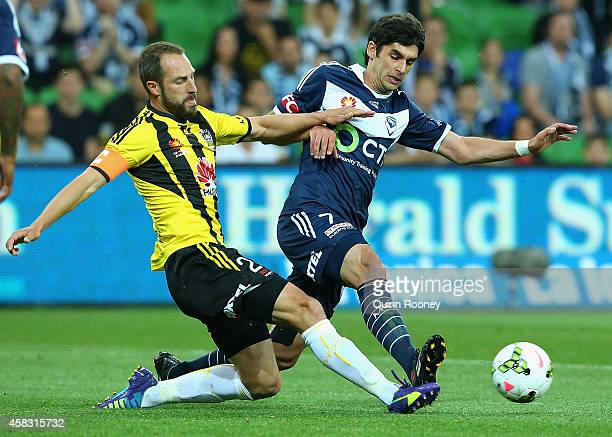 Andrew Durante of the Phoenix and Guilherme Finkler of the Victory contest for the ball during the round four ALeague match between the Melbourne...