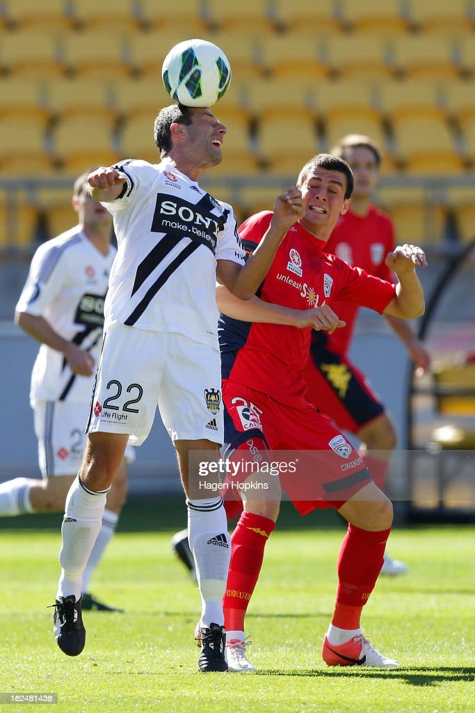 Andrew Durante of the Phoenix heads the ball while Tomi Juric of Adelaide looks on during the round 22 A-League match between the Wellington Phoenix and Adelaide United at Westpac Stadium on February 24, 2013 in Wellington, New Zealand.