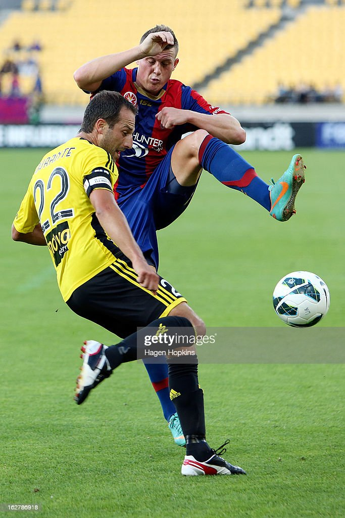 <a gi-track='captionPersonalityLinkClicked' href=/galleries/search?phrase=Andrew+Durante&family=editorial&specificpeople=221014 ng-click='$event.stopPropagation()'>Andrew Durante</a> of the Phoenix looks to clear the ball past the defence of Dominik Ritter of the Jets during the round 26 A-League match between the Wellington Phoenix and the Newcastle Jets at Westpac Stadium on February 27, 2013 in Wellington, New Zealand.