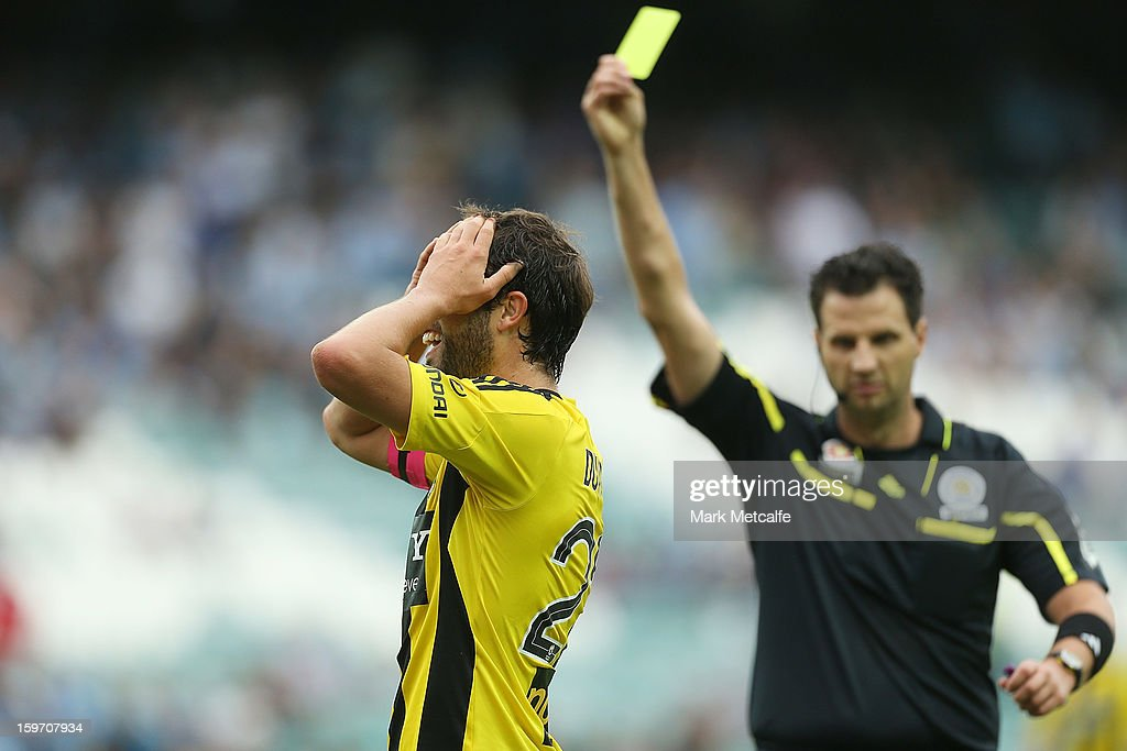 Andrew Durante of the Phoenix reacts to conceding a penalty and being booked during the round 17 A-League match between Sydney FC and the Wellington Phoenix at Allianz Stadium on January 19, 2013 in Sydney, Australia.