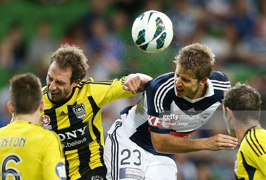 Andrew Durante of the Wellington Phoenix (L) contests for the ball against Adrian Leijer of the Melbourne Victory during the round 15 A-League match between the Melbourne Victory and Wellington Phoenix at AAMI Park on January 5, 2013 in Melbourne, Australia.