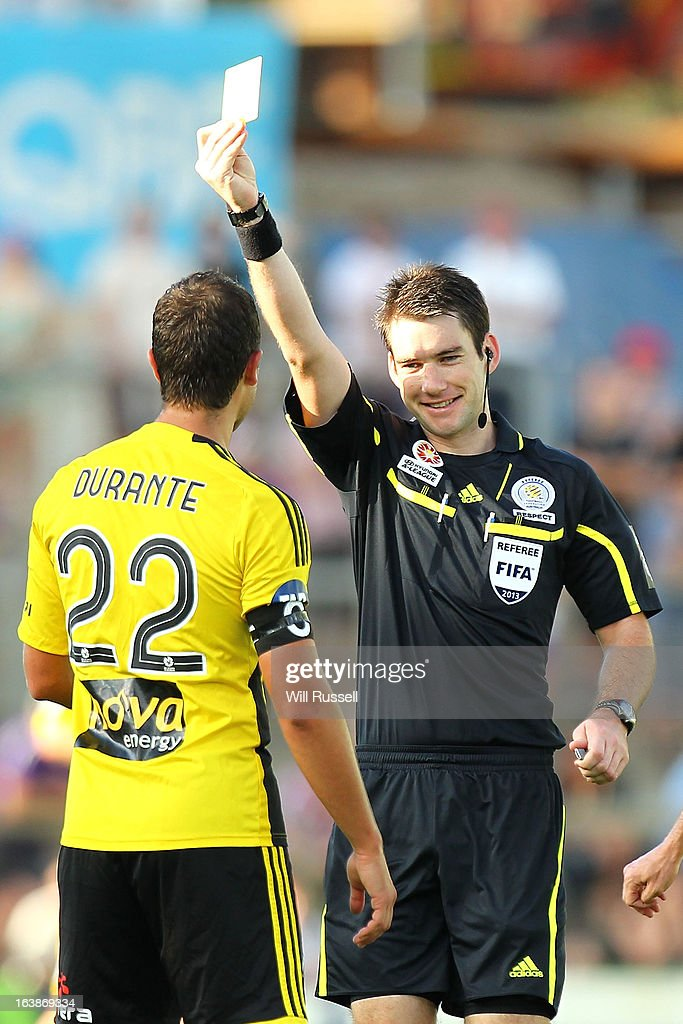 Andrew Durante of the Wellington Phoenix is shown the yellow card for a foul against Liam Miller of the Glory during the round 25 A-League match between the Perth Glory and the Wellington Phoenix at nib Stadium on March 17, 2013 in Perth, Australia.