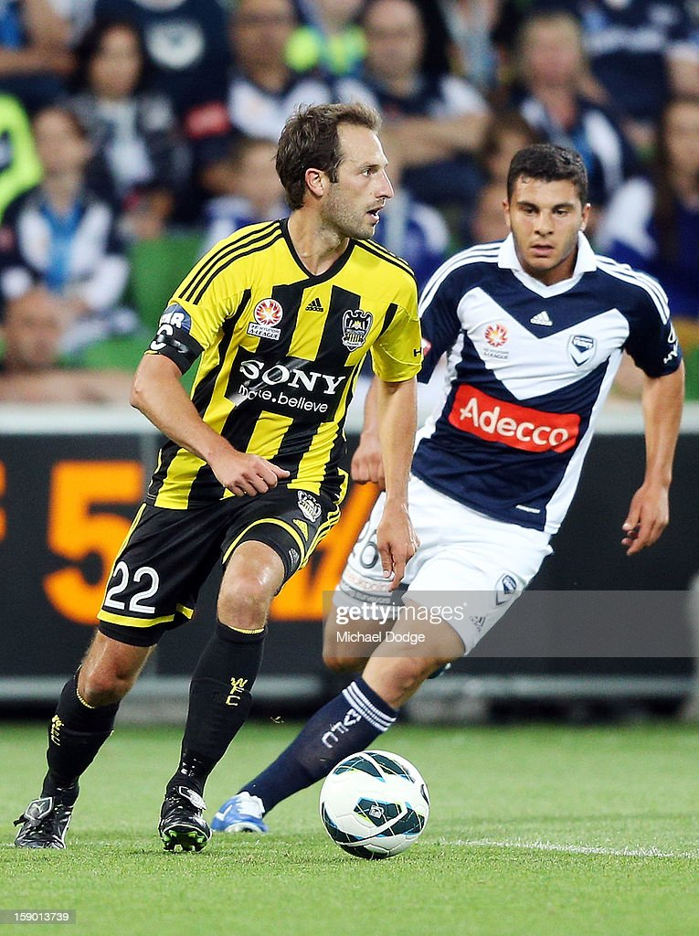 Andrew Durante of the Wellington Phoenix runs with the ball during the round 15 A-League match between the Melbourne Victory and Wellington Phoenix at AAMI Park on January 5, 2013 in Melbourne, Australia.