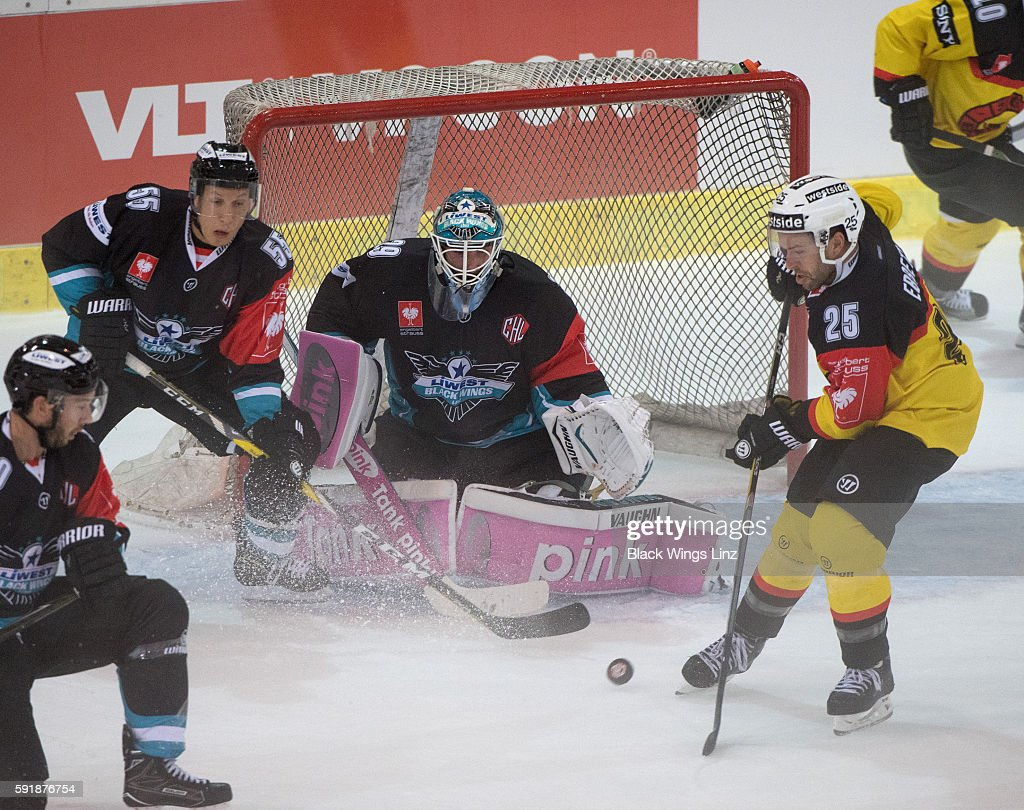 Andrew Ebbett of SC Bern in front of goalkeeper Michael Ouzas of Black Wings Linz during the Champions Hockey League match between Black Wings Linz...