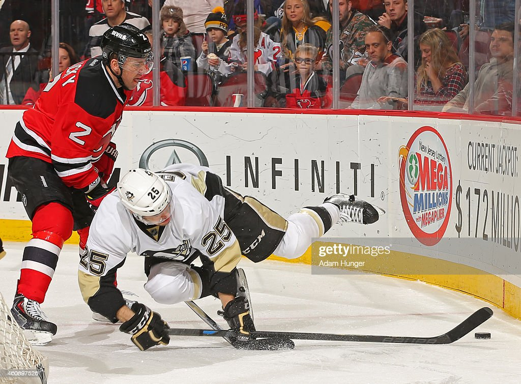 Andrew Ebbett of the Pittsburgh Penguins gets tripped up in front of Marek Zidlicky of the New Jersey Devils during the third period at the...