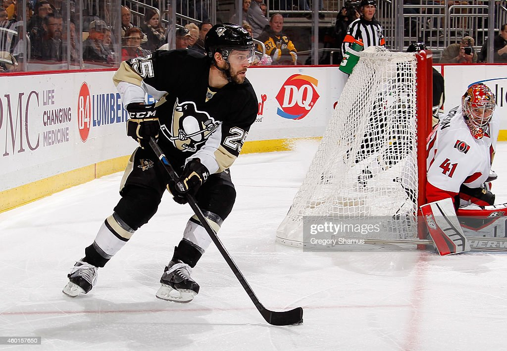 Andrew Ebbett of the Pittsburgh Penguins moves the puck against the Ottawa Senators at Consol Energy Center on December 6 2014 in Pittsburgh...