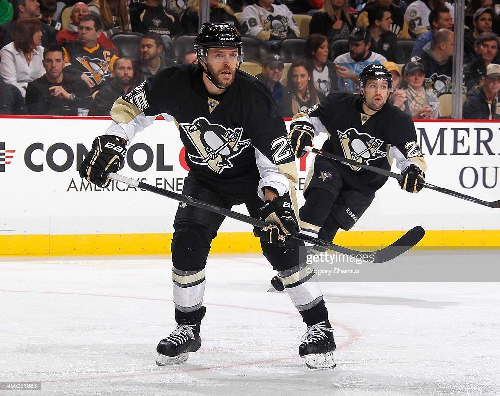Andrew Ebbett of the Pittsburgh Penguins skates against the San Jose Sharks on December 5 2013 at Consol Energy Center in Pittsburgh Pennsylvania