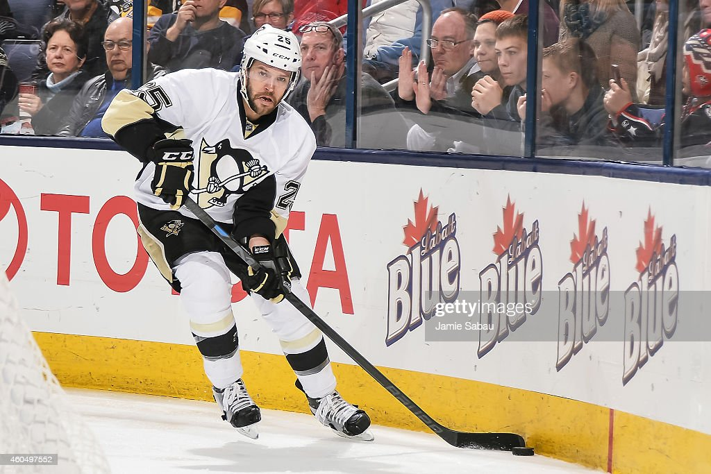 Andrew Ebbett of the Pittsburgh Penguins skates with the puck against the Columbus Blue Jackets on December 13 2014 at Nationwide Arena in Columbus...