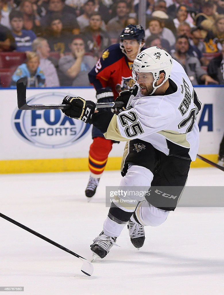 Andrew Ebbett of the Pittsburgh Penguins takes a shot on goal during a game against the Florida Panthers at BBT Center on December 22 2014 in Sunrise...