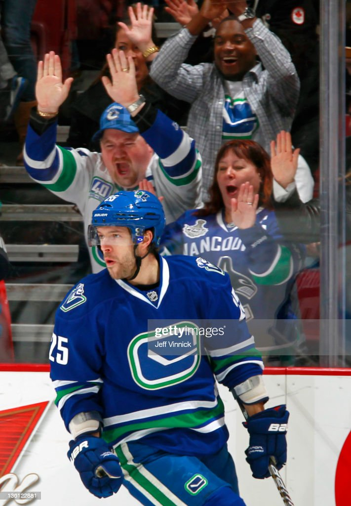 Andrew Ebbett of the Vancouver Canucks and fans celebrate his goal against the Edmonton Oilers during the NHL game at Rogers Arena December 26 2011...