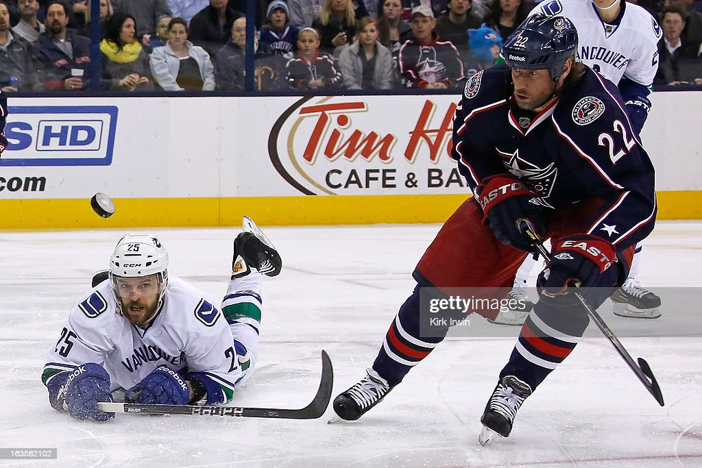 <a gi-track='captionPersonalityLinkClicked' href=/galleries/search?phrase=Andrew+Ebbett&family=editorial&specificpeople=4143929 ng-click='$event.stopPropagation()'>Andrew Ebbett</a> #25 of the Vancouver Canucks dives in an attempt to knock the puck away from Vinny Prospal #22 of the Columbus Blue Jackets during the second period on March 12, 2013 at Nationwide Arena in Columbus, Ohio.