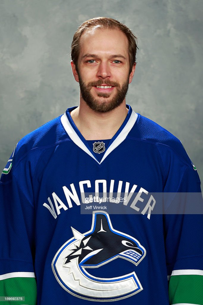 Andrew Ebbett of the Vancouver Canucks poses for his official headshot for the 201213 NHL season on January 13 2013 at Rogers Arena in Vancouver...