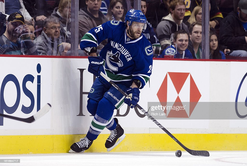 Andrew Ebbett #25 of the Vancouver Canucks skates with the puck during NHL action against the Minnesota Wild on February 12, 2013 at Rogers Arena in Vancouver, British Columbia, Canada.