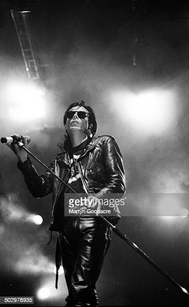 Andrew Eldritch of gothic rock band Sisters Of Mercy performs on stage Wembley Arena London United Kingdom 26th November 1990
