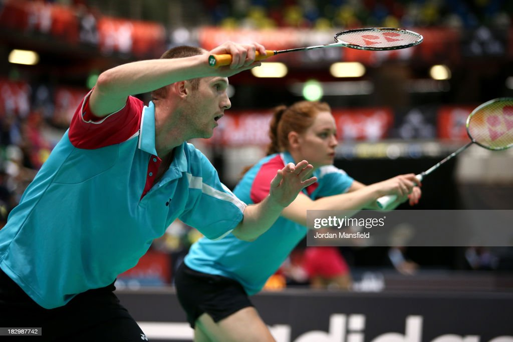 Andrew Ellis (L) and Lauren Smith (R) of England in action in their mixed doubles match against Heather Oliver and Chris Langridge of England during Day 3 of the London Badminton Grand Prix at The Copper Box on October 3, 2013 in London, England.