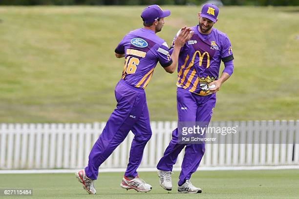 Andrew Ellis is congratulated by Ben Hilfenhaus of the Kings after taking a catch to dismiss Arjun Nair of the Thunder during the T20 practice match...