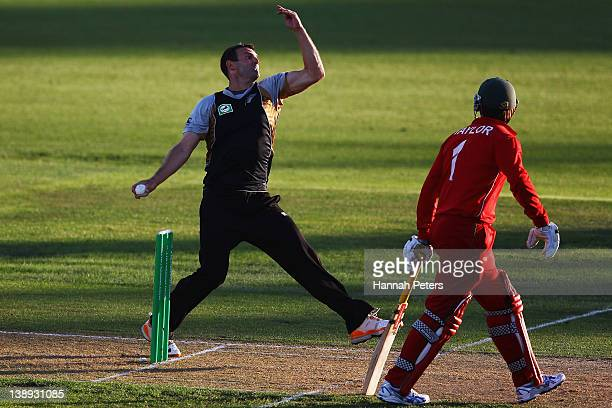 Andrew Ellis of New Zealand bowls during the second International Twenty20 match between New Zealand and Zimbabawe at Seddon Park on February 14 2012...