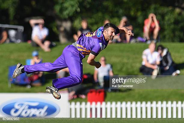 Andrew Ellis of the Kings bowling during the McDonalds Super Smash T20 match between the Canterbury Kings and Wellington Firebirds at Hagley Oval on...