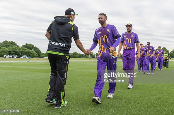 Andrew Ellis of the Kings is congratulated by Shane Watson of the Thunder following the T20 practice match between Canterbury Kings and Sydney...