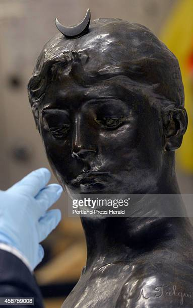 Andrew Eschelbacher an associate curator at the Portland Museum of Art looks over a piece by JeanAlexandreJoseph Falguiere Bust of Diana at the...