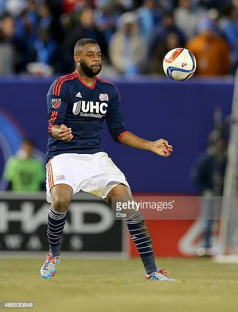 Andrew Farrell of New England Revolution stops the ball in the second half against the New York City FC during the inaugural game of the New York...