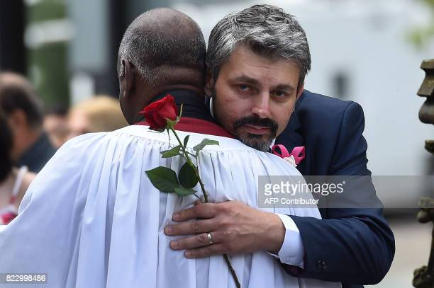 Andrew father of Manchester Arena bomb victim SaffieRose Roussos receives comfort from a member of the clergy prior to her funeral service at...