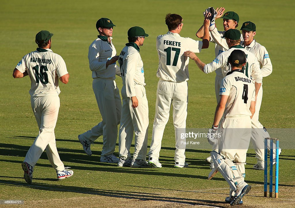 Andrew Fekete of the Tigers celebrates with team mates after dismissing Cameron Bancroft of the Warriors during day three of the Sheffield Shield match between the Western Australia Warriors and the Tasmania Tigers at the WACA on February 14, 2014 in Perth, Australia.