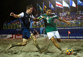Andrew Feld of USA competes for the ball with Francisco Cati of Mexico during day six of the CONCACAF Beach Soccer Championships El Salvador 2015...