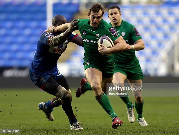 Andrew Fenby of London Irish hands off the tackle of Mahamadou Diaby of Grenoble during the European Rugby Challenge Cup pool 1 match between London...