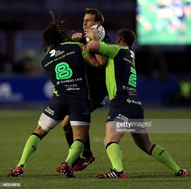 Andrew Fenby of London Irish is tackled by Josh Navidi and Matthew Rees of Cardiff during the European Rugby Challenge Cup match between Cardiff...