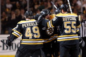 Andrew Ference of the Boston Bruins celebrates with his teammates Johnny Boychuk Rich Peverley and David Krejci after scoring a goal in the second...