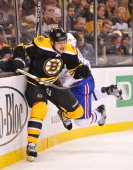 Andrew Ference of the Boston Bruins checks against PK Subban of the Montreal Canadiens in Game Two of the Eastern Conference Quarterfinals during the...