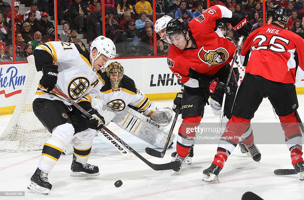 <a gi-track='captionPersonalityLinkClicked' href=/galleries/search?phrase=Andrew+Ference&family=editorial&specificpeople=202264 ng-click='$event.stopPropagation()'>Andrew Ference</a> #21 of the Boston Bruins clears the loose puck from in front of <a gi-track='captionPersonalityLinkClicked' href=/galleries/search?phrase=Anton+Khudobin&family=editorial&specificpeople=722106 ng-click='$event.stopPropagation()'>Anton Khudobin</a> #35 as <a gi-track='captionPersonalityLinkClicked' href=/galleries/search?phrase=Zdeno+Chara&family=editorial&specificpeople=203177 ng-click='$event.stopPropagation()'>Zdeno Chara</a> #33 of the Boston Bruins defends against <a gi-track='captionPersonalityLinkClicked' href=/galleries/search?phrase=Mika+Zibanejad&family=editorial&specificpeople=7832310 ng-click='$event.stopPropagation()'>Mika Zibanejad</a> #93 of the Ottawa Senators, during an NHL game, at Scotiabank Place, on March 21, 2013 in Ottawa, Ontario, Canada.