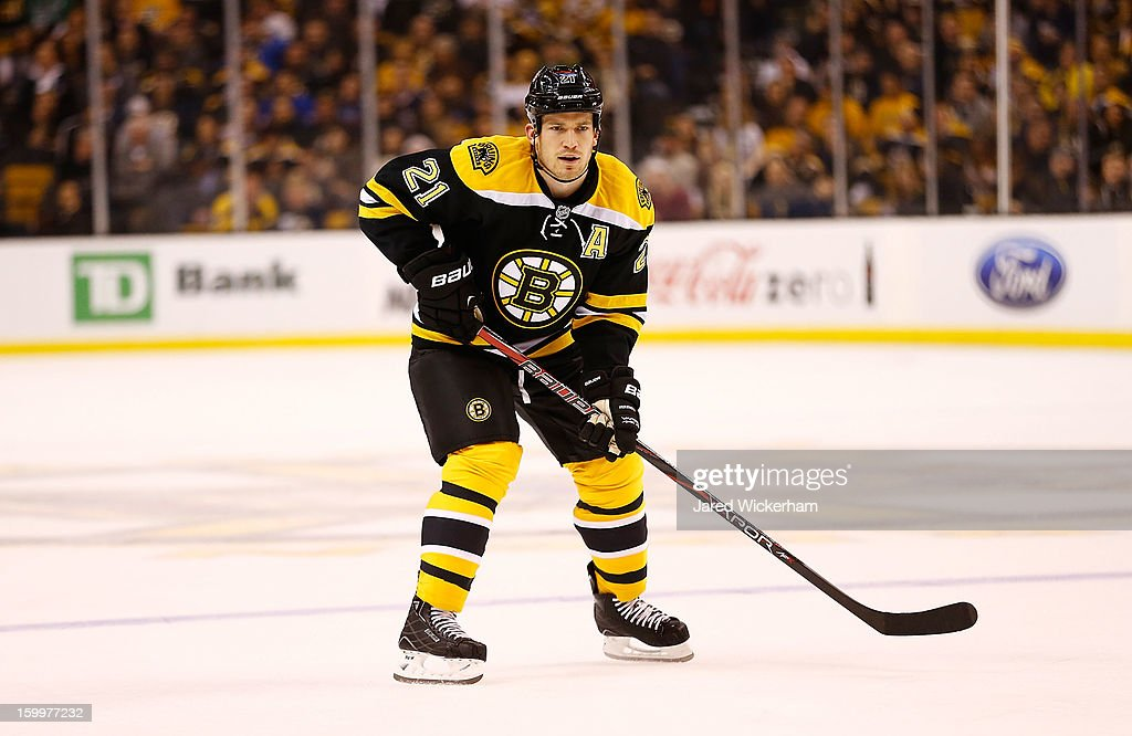 Andrew Ference #21 of the Boston Bruins plays against the New York Rangers during the season opener game on January 19, 2013 at TD Garden in Boston, Massachusetts.