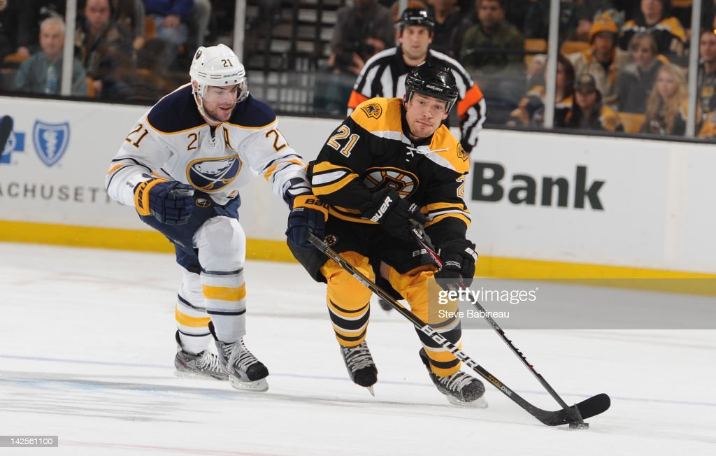 <a gi-track='captionPersonalityLinkClicked' href=/galleries/search?phrase=Andrew+Ference&family=editorial&specificpeople=202264 ng-click='$event.stopPropagation()'>Andrew Ference</a> #21 of the Boston Bruins skates with the puck against <a gi-track='captionPersonalityLinkClicked' href=/galleries/search?phrase=Drew+Stafford&family=editorial&specificpeople=220617 ng-click='$event.stopPropagation()'>Drew Stafford</a> #21 of the Buffalo Sabres at the TD Garden on April 7, 2012 in Boston, Massachusetts.