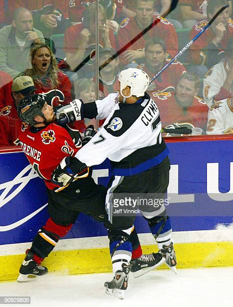 Andrew Ference of the Calgary Flames is hit by Ben Clymer of the Tampa Bay Lightning during the second period in game six of the NHL Stanley Cup...